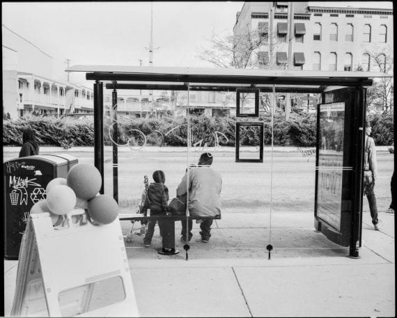 Photo of man with son at bus stop